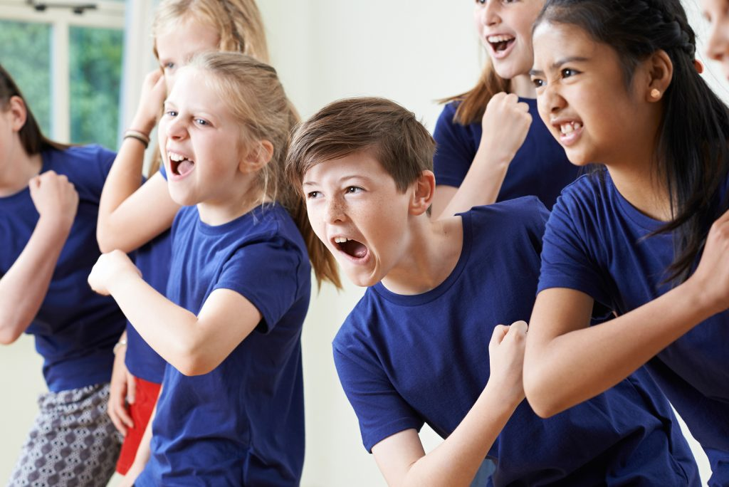 Group Of Children Enjoying Music Class Together